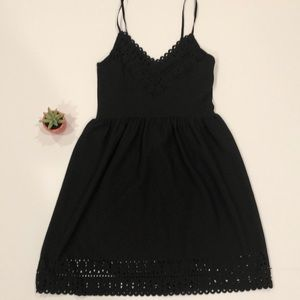 Simple black dress with cutout detail